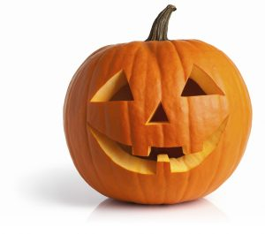 Jack-o-lantern isolated with shadow and reflection. Clipping path provided.